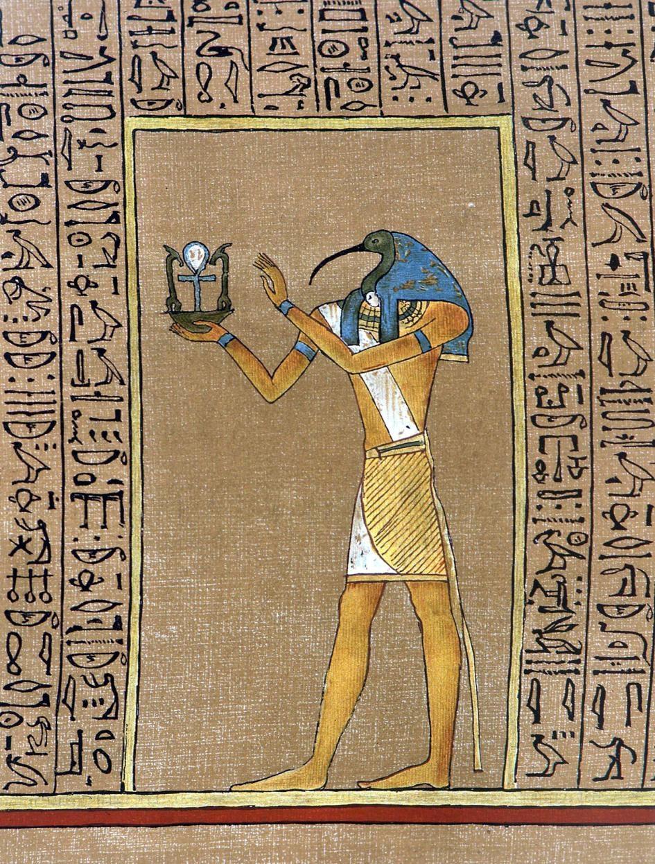 埃及神祇托特(Thoth)傳統上的形象有著聖䴉頭,手持著象徵健康與力量的生命之符(Ankh)。本圖源自埃及《亡者之書》(Book of the Dead)其中的《胡內弗手抄本》(Papyrus of Hunefer)。 PHOTOGRAPH BY CHARLES WALKER COLLECTION, ALAMY