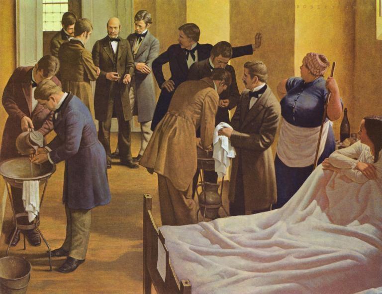 畫家羅伯特.托姆(Robert Thom)的作品,描繪塞默維斯(圖中央)在奧地利的維也納綜合醫院裡監督醫生,要求他們在為產科病人檢查前先洗手。PHOTOGRAPH BY GL ARCHIVE, ALAMY