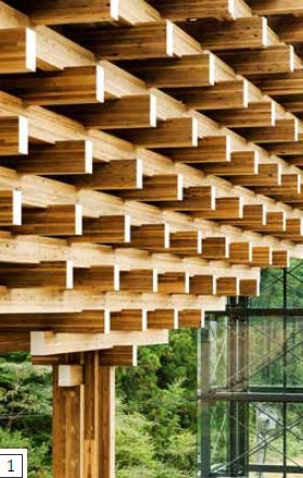 立柱和電梯井-博物館的橫梁從中央的柱子以懸臂設計向外出挑,每層都比下層還寬一點,所以建築物可以橫跨下方的空間。中央的柱子無法單獨負荷所有木材的重量,因此兩端的玻璃和鋼構電梯井能提供額外的支撐。深色的金屬支架與電 梯井的透明牆面能有效降低視覺衝擊,也讓後方的森林得以顯露,使焦點落在木頭結構上。