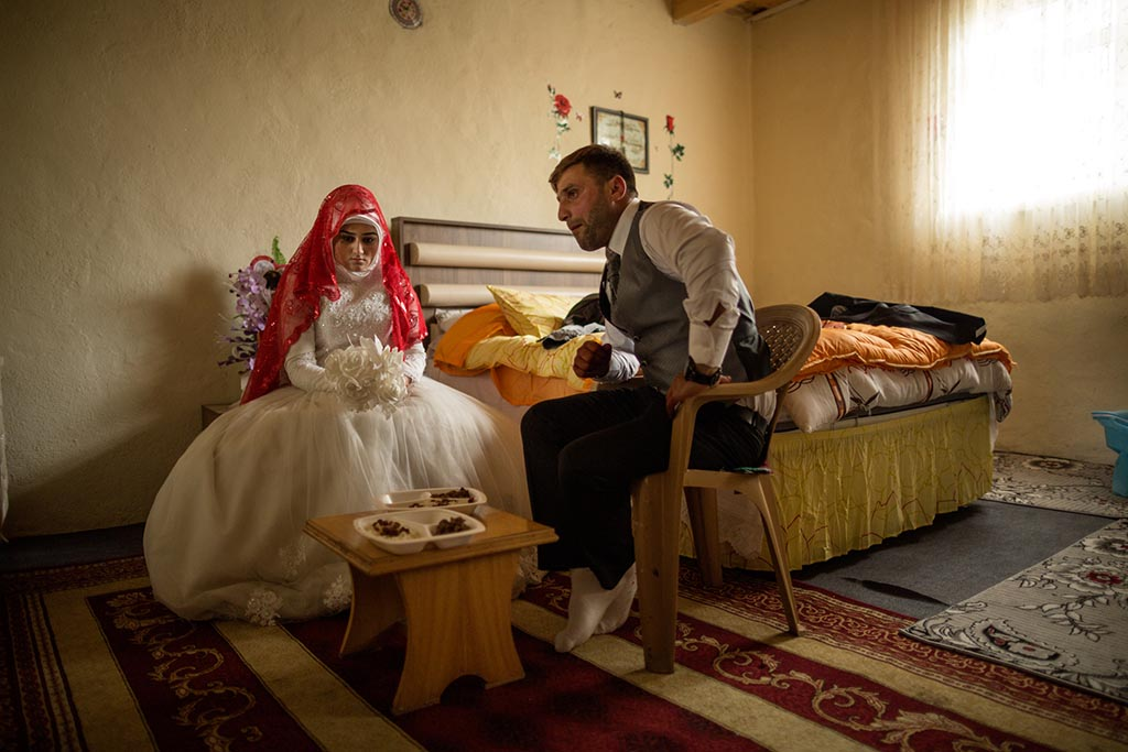 Wedding celebration of Adem Yılmaz Turkish, 25, snd his wife, Seher Demirel, 18 Ages, at the grooms home in Karahan village, Kars, Turkey. Adem is an Azeri while Seher is Kurdish, a rare marriage of often conflicting ethnic groups. Karahan village was once solely populated by Armenians. When the genocide began in 1915, all Armenians left their homes and everything behind. Today, Karahan is populated by Azeri's and Kurks, living in the exact same homes that once were owned by Armenians.