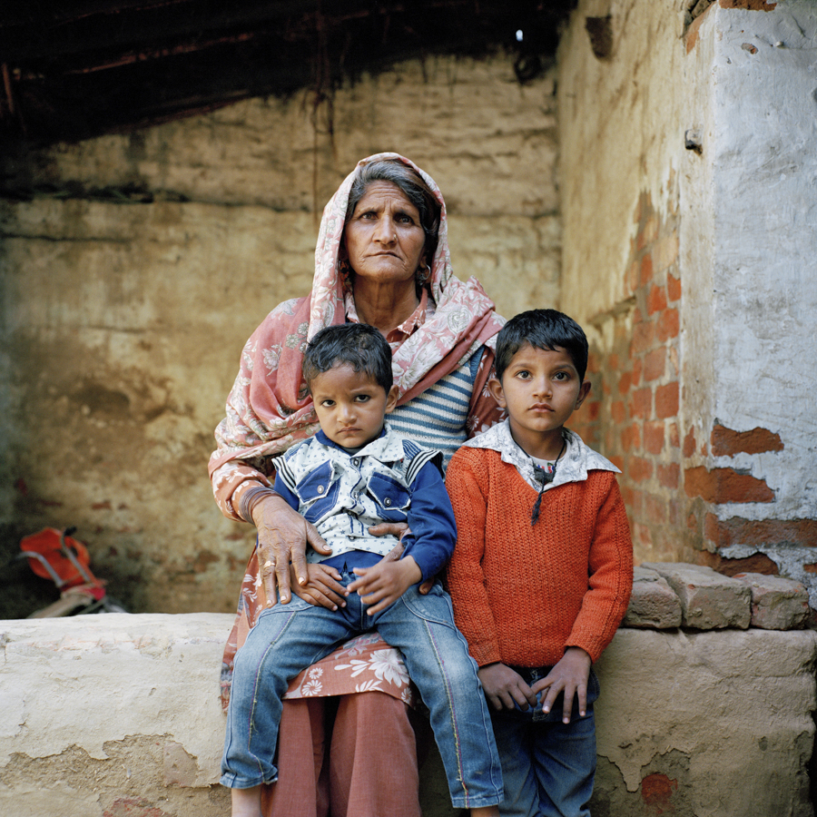 Feb. 8 2017 - Hasina, 62 poses for a portrait with her grandchildren Lavish, 2 and Ayan Sefi, 4 at their home in Panipat, Haryana. Hasina and her family are Muslims living among other Hindu Dalits in a village located directly next to the highway.