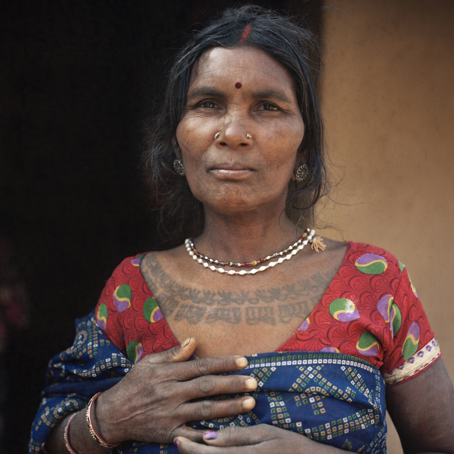 "Dec. 20 2016 - Sori Devi, 50 of Kolodohar, Jharkhand adorns a Godna, a term used across tribes in central and eastern India to refer to traditional tattoos. Of the low-caste Chamar group, this tattoo is inscribed among many women in the village and was traditionally used among low-caste women as a form of uglification to protect against the wandering eye of upper-caste men. ""I'm feeling very vulnerable at this time"" she expressed. Her husband has migrated, like many men in her village, for brick making work in Uttar Pradesh and Bihar. ""We are having a very horrible time because of the conditions we are facing."""