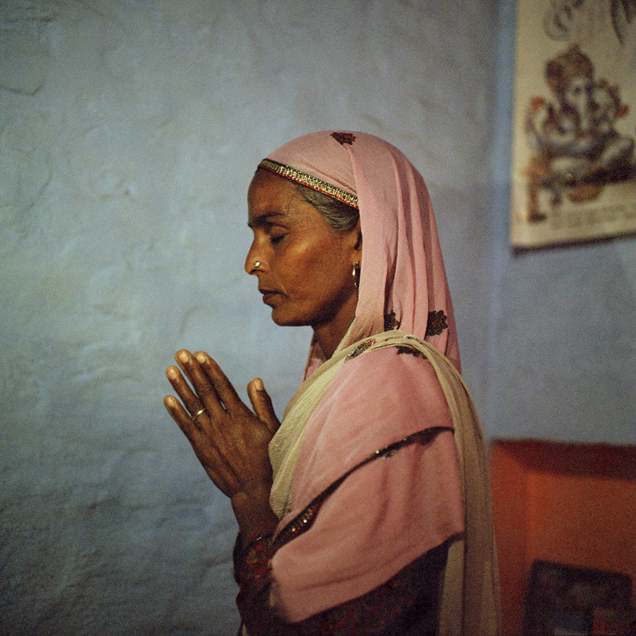 "Feb. 9 2017 - Darshani, 41, of the Balmiki caste prays in her home in Bhapur, Haryana.""I bought the gold I wear for myself…and I own this house."" After two years of physical abuse by her drunken husband, Darshani left towards her mother's village, took out a loan, and did agriculture work to build her own life and raise her two children. After thirteen years, her husband has pleaded for forgiveness, sobered up and supports their kids in striving for a better future."