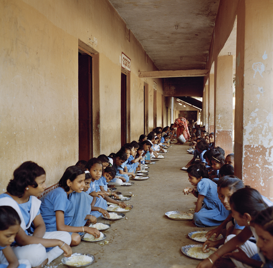 "Dec. 16 2016 - Children participate in the government midday meal scheme at Pathapur Division School in Odisha, India. Dalit children are on the right during mealtime so as not to pollute the food of the other children. A teacher from the school said ""It's very hard, we are doing our best, but what we see is very sad."""