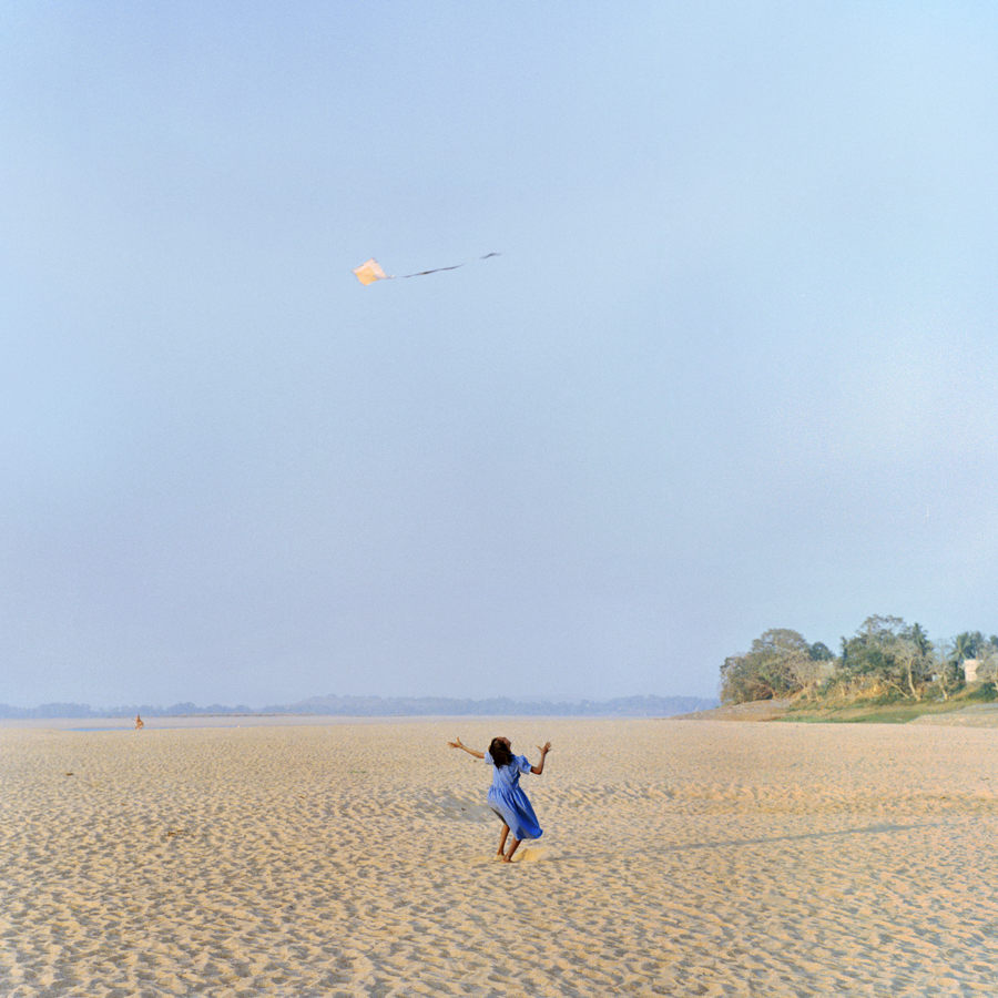 Dec. 16 2016 - A girl from the Dalit village of Harirajpur chases a kite on the dried up Mahanadi riverbed in Odisha. This is the primary source of water for many villagers, who, living in one of India's poorest states, face the brunt of the dry season by having to walk long distances to retrieve drinking water.